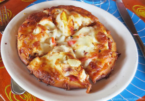 the perfect couples getaway -tensing pen jamaica- jerk chicken pizza